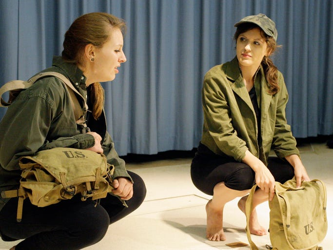 Kelsey Vohen of Two Rivers, left,  performs with Colleen Muchat during a rehearsal of Alice and Eugene: The Lucky Ones Tuesday July 15, 2014 at the Military Heritage Museum in Sheboygan.