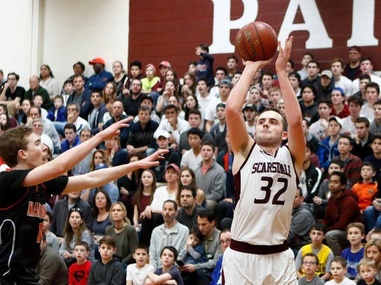 Scarsdale's Will Hoffman (32) puts up a three point shot during their 61-58 win over Mamaroneck in the class AA playoff basketball game at Scarsdale High School in Scarsdale on Saturday, February 18, 2017.