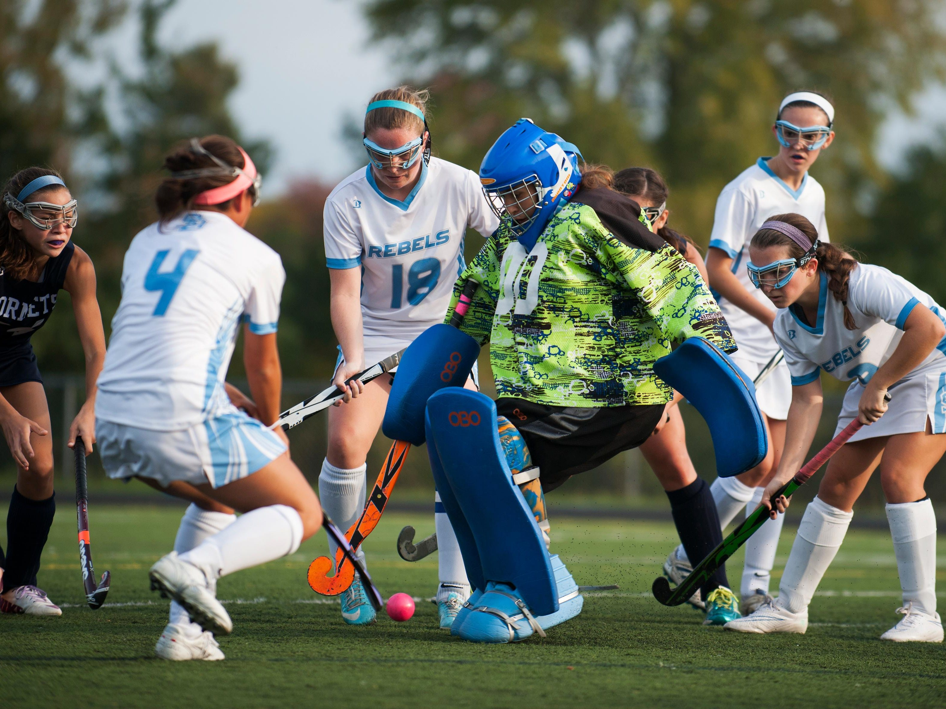 South Burlington goalie Liz Sargent (00) makes a save during a high school field hockey game last year.