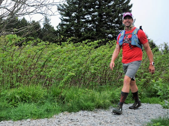 Kenny Capps makes his way along the Mountains-to-Sea Trail two days before finishing his trek across to state to raise awareness for multiple myeloma.