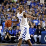 Kentucky Wildcats guard Tyler Ulis (3) dribbles the ball against the Wright State Raiders in the first half at Rupp Arena.