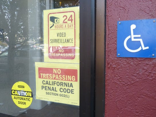 Signs adorn a window at the Lorenz Hotel in downtown