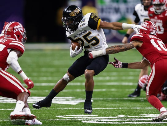 Southern Miss running back Ito Smith is Conference