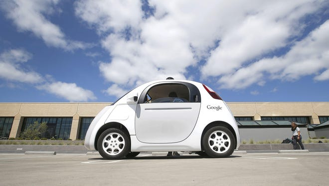 Google's new self-driving prototype car is presented during a demonstration at the Google campus in Mountain View, Calif. in 2015.