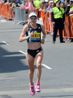 First American female finisher Neely Spence Gracey at the 25-mile mark of the Boston Marathon. The Shippensburg University grad ran in York County growing up with her Olympic marathon father, Steve Spence.