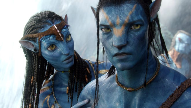 Neytiri, left, (voice of Zoe Saldana) and Jake (Sam Worthington in 2009's 'Avatar.' Sequels to James Cameron's international blockbuster are expected to go into production later this year.