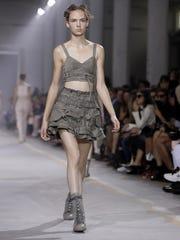 A model wears a creation part of the Diesel Black women's