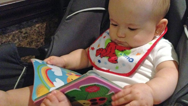 Isabella loves books. She gravitates toward books and often chooses them over other toys.