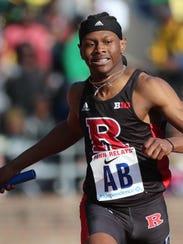 Taj Burgess, of Rutgers, crosses the finish line after