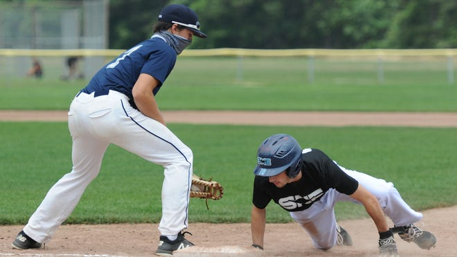 SNE's Jack O'Neil, right, dives back to first base manned by Team Cape Cod's Cam Taubert in a pickoff attempt in the first inning of Sunday's game at Dennis-Yarmouth.