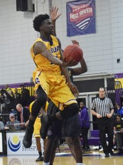 LSUA's Brandon Moss (21) goes for two against LSUS.