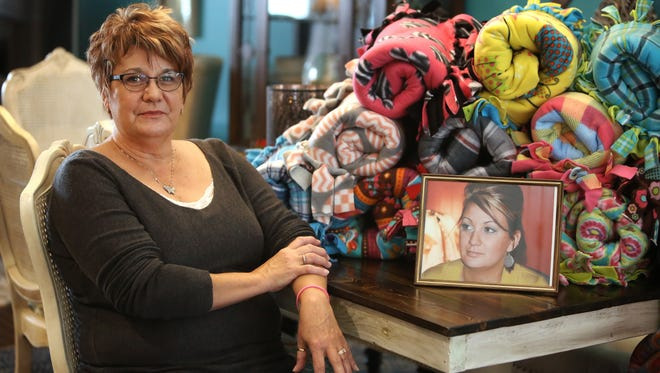 Jenni Schuh Woodruff's daughter, Christi, died in 2011, of an infection caused by a contaminated needle, from IV drug use. Jenni is an advocate for needle exchange and has done multiple speaking engagements bringing awareness to the topic. Now, she's heading up an effort to make 100 fleece blankets for women at Transitions Inc. of NKY's WRAP (Women's Recovery Addiction Program) House.