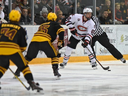St. Cloud State's Jimmy Schuldt skates with the puck during the first period Jan. 1 game at the Herb Brooks National Hockey Center.  Schuldt has been on the Huskies' top defensive pairing since the beginning of the season as a freshman.