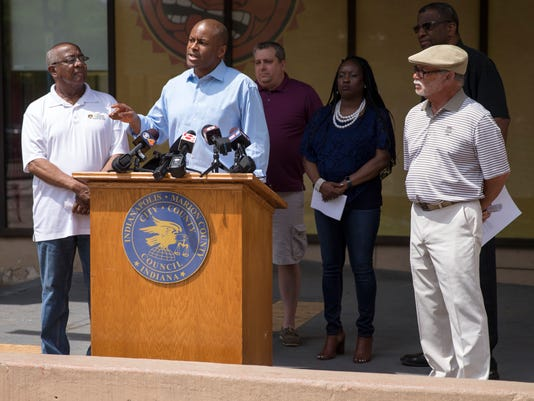 Vos Osili, City-County Council President, stands with a non-partisan group from the counsil to announce they will be examining the role of the city's merit board through a series of community meetings, Indianapolis.