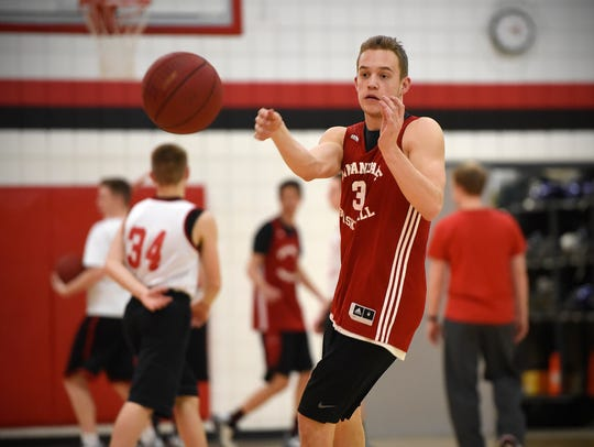 Brock Fobbe passes to a teammate during practice Monday