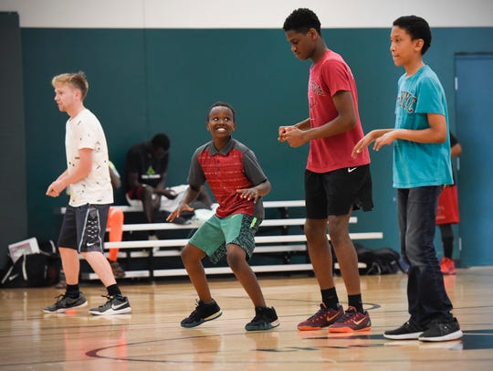 Basketball players join a free Zumba class Friday,