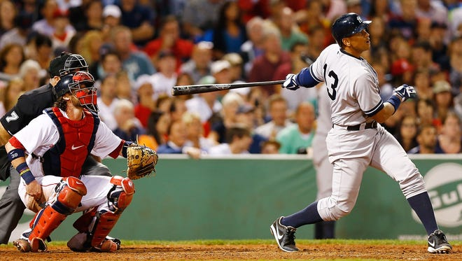 Alex Rodriguez of the New York Yankees hits a solo home run off of Ryan Dempster of the Boston Red Sox at Fenway Park in Boston.