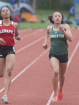 Pemberton's Aliya Taylor, right, finishes first ahead of Lenape's Jasmine Staten during the 400-meter run at the Burlington County Open at Rancocas Valley High School in May.