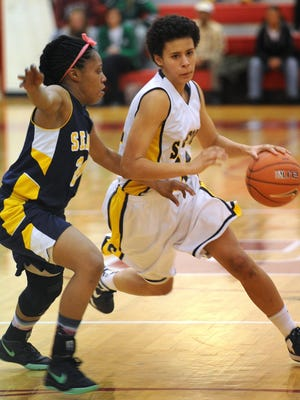 Alison Lewis (right), seen during her Sanford days, has transferred to Delaware from Providence.
