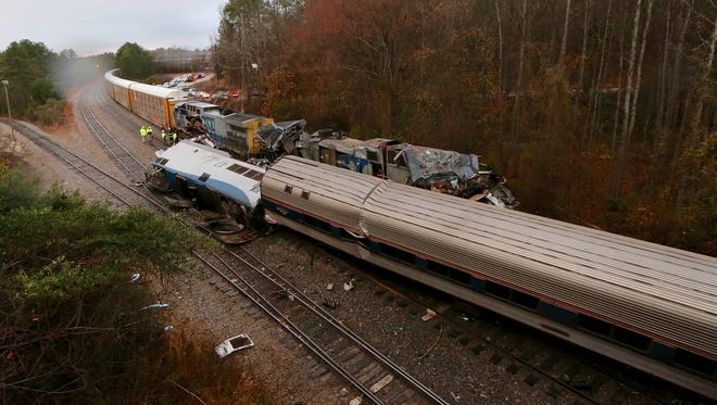 Authorities investigate the scene of a fatal Amtrak train crash in Cayce, South Carolina, Sunday, Feb. 4, 2018. At least two people were killed and dozens injured when an Amtrak passenger train collided with a CSX freight train.