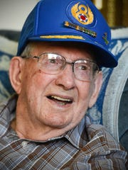 Don Fish, 100, tells stories about being a co-pilot of a B-17 bomber flying missions over Germany. He is shown Thursday, Oct. 19, at Country Manor in Sartell.