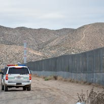 A U.S. Border Patrol agent patrols Sunland Park along the U.S.-Mexico border next to Ciudad Juarez on Jan. 4, 2016. The area is among more than 600 miles of border protected by fencing.