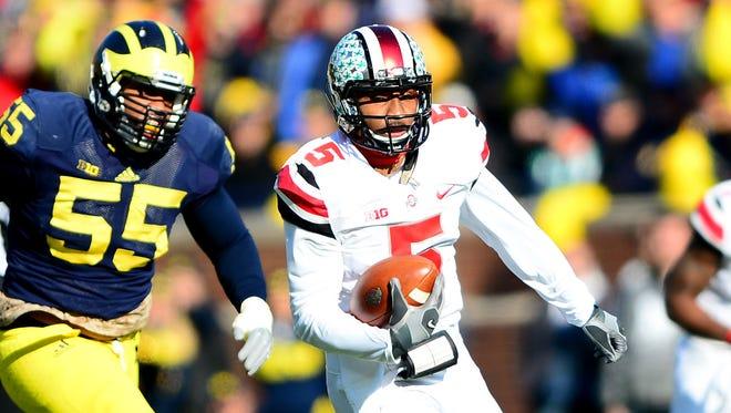 Ohio State quarterback Braxton Miller (5) runs the ball for a touchdown during the first quarter Saturday against Michigan at Michigan Stadium.