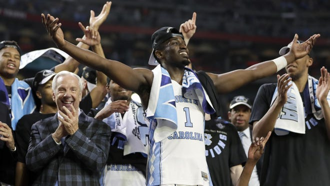 North Carolina's Theo Pinson celerates with head coach Roy Williams after the Tar Heels beat Gonzaga in the NCAA Tournament championship game Monday in Glendale, Ariz.