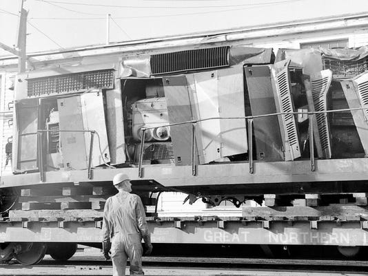 636620883567013586-a-1971-05-BN-employee-looking-one-of-the-engines-dameged-at-the-Sheffels-accident.-Chuck-Hatler-photo.jpg
