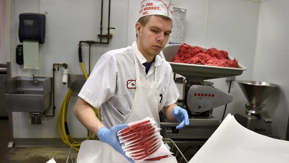 Ryan Pfannenstein stacks freshly-formed Joe burgers