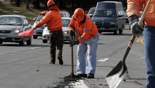 New York State DOT workers cold-patch fill a pothole along Route 6 in Shrub Oak, down the way from the Putnam stretch, back in 2006.