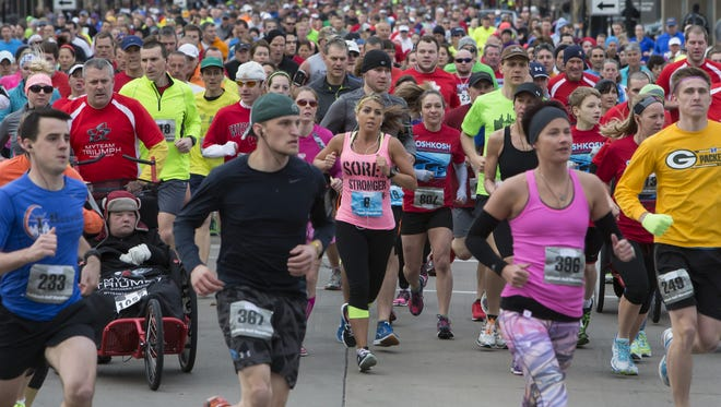 Runners start off on Main Street for the Oshkosh Marathon, Half Marathon, Relay and 5K on April 19, 2015. This year includes new events.