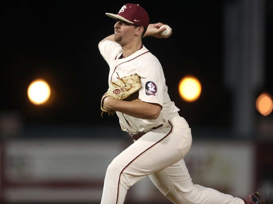 FSU's Conor Grady pitches against Louisville during Seminoles 8-7 win over Louisville at Dick Howser Stadium on Friday.