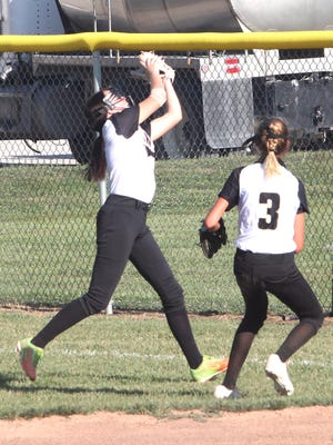 Cairo right fielder Abi Ogle catches up to glove a shallow fly ball while second baseman Iszy Zenker (#3) arrives to provide some assistance should it be needed during a home softball game played earlier this 2020 fall season. Cairo Lady 'Cats defeated New Franklin 4-2 on Tuesday.