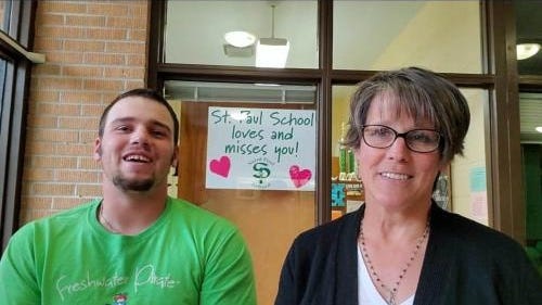 WIU student and SRC Spanish tutor, Drew, is pictured with his mother, Laura Cody, St. Paul School Principal. Drew has been tutoring St. Paul students during the pandemic.
