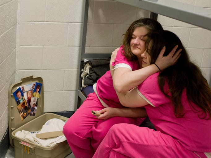 Inmate Crystal French, 38, left, is comforted by cellmate