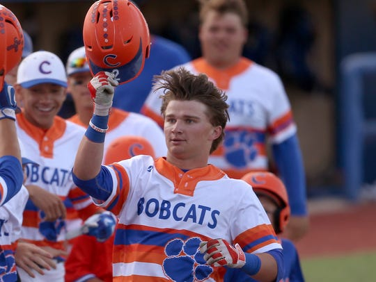 Central's Brock Martin celebrates with his teammates after hitting a home run against Waco Midway this past season.