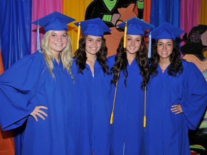 Kenzie Bowland, Auggie Gorecki, Alycia Chmielewski and Allie Mumm take photos together before their graduation on Saturday, May 31, at Foley High School.