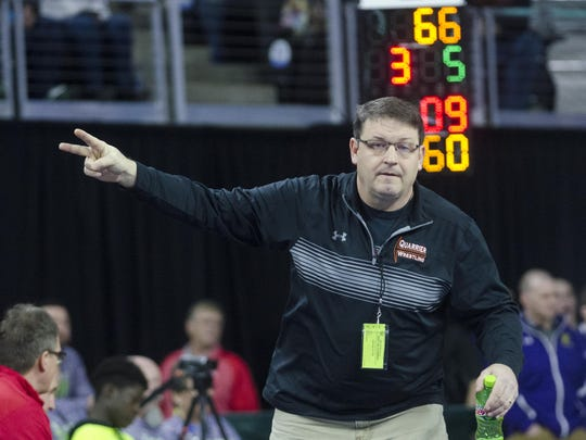 Dell Rapids wrestling coach Craig Jorgensen signals for points from the referee Friday, Feb. 23, during the Class A state wrestling tournament at the Denny Sanford Premier Center in Sioux Falls.