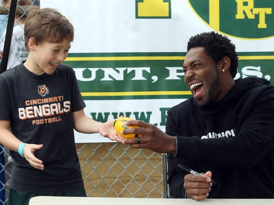Nine-year-old Kian Lago of Rockaway shares a laugh with former Jets cornerback Antonio Cromartie before the Rockaway Twp Rockets Punt, Pass and Kick contest at Peterson Field.
