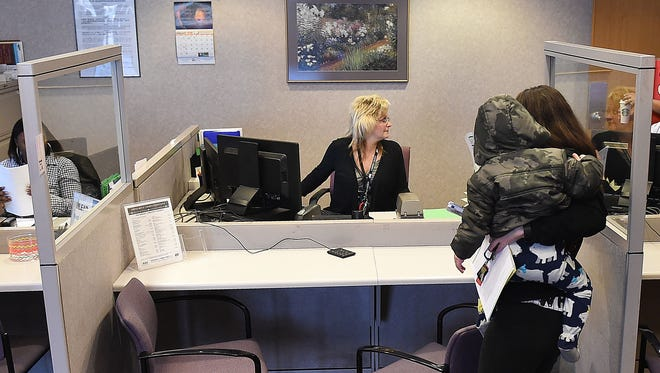 Eligibility Tech Michelle Porter sees clients at the Larimer County Human Services office on Monday, February 22, 2016.  Caseloads for these employees have increased along with wait times for clients, partly because more people are applying for Medicaid to avoid a tax penalty.