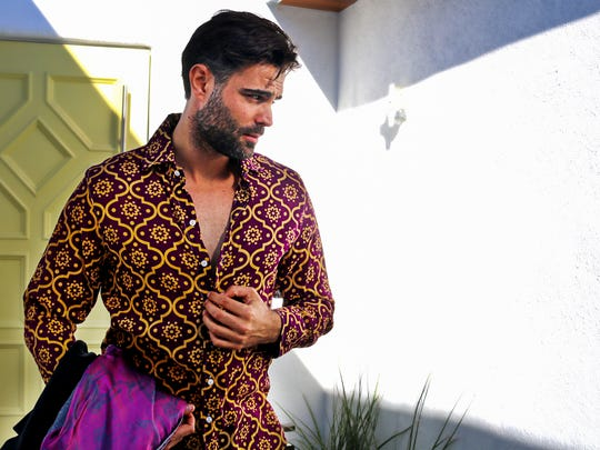 A model wears the Burgundy Arabic shirt.
