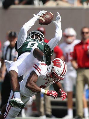 Michigan State wide receiver Donnie Corley makes a catch against the Wisconsin Badgers' Sojourn Shelton during first-half action Saturday, Sept. 24, 2016, at Spartan Stadium in East Lansing.