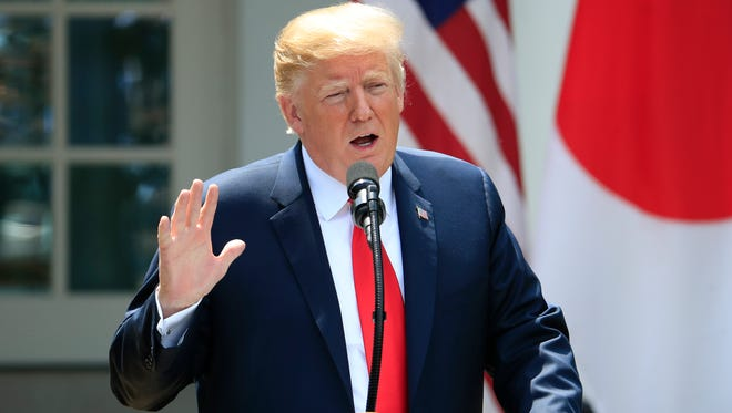 President Donald Trump speaks during a news conference with Japanese Prime Minister Shinzo Abe in the Rose Garden at the White House Thursday. (AP Photo/Manuel Balce Ceneta)
