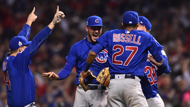 Anthony Rizzo, Kris Bryant, Addison Russell and Mike Montgomery celebrate after defeating the Cleveland Indians in Game 7.