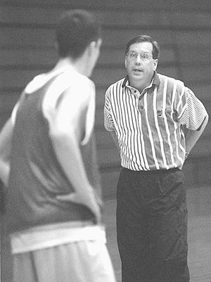 Taken in 1997, Badin's basketball coach Gerry Weisgerber gives some advice to a player during a final practice at the school before heading off to the state tournament.