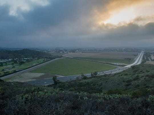 An expanse of farmland lies at the base of the Conejo Grade.