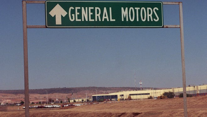 A sign announced the entrance to GM plant in Silao, Mexico, in this 1998 file photo