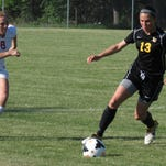 Emily Voss (13) earned all-state recognition in Division 4 last season and will be a leader for Lansing Christian..