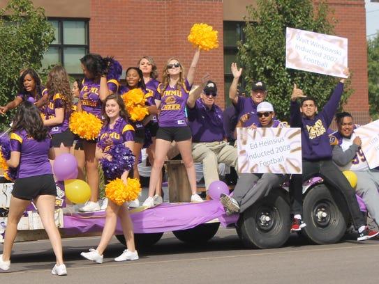 Western New Mexico University's cheerleaders chant